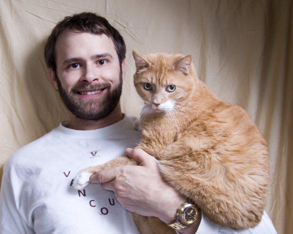 Jade Sambrook holding Mario the cat for a family photo