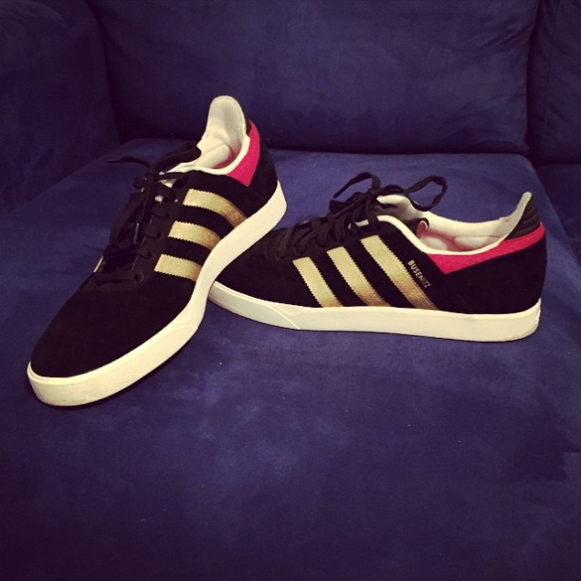 An Instagram photo of Jade Sambrook's Adidas Busenitz black, gold & red skater shoes