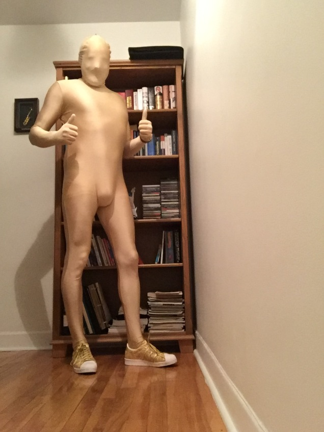 Jade Sambrook wearing a gold morphsuit for Halloween.